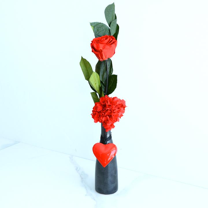 Soliflore de fleurs séchées rouges